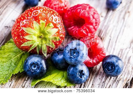 Blueberries, raspberries, strawberries.Garden and forest fruits