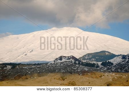 clouds on the snowy volcano Etna National Park, Sicily