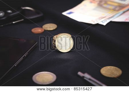 euro coins on a black background
