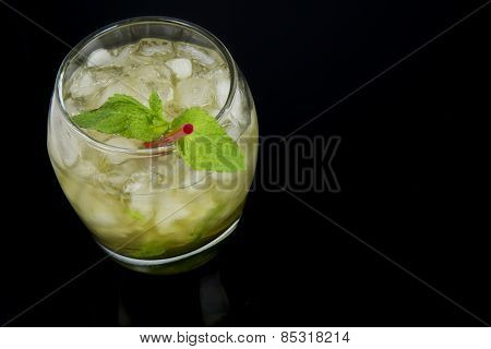 Mint Julep Seen from the Side and Above on Black Background