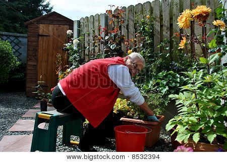 senior lady stretching to do her gardening