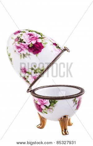 a porcelain faberge style decorated egg isolated over a white background poster