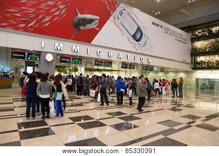 SINGAPORE - JANUARY 26, 2014:  Changi International Airport is a major aviation hub in Asia, serves more than 100 airlines operating 6,100 weekly flights connecting Singapore to over 220 cities.