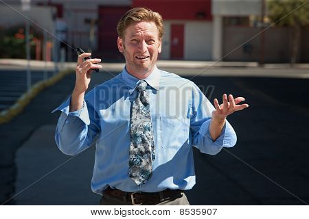Good-looking Guy Frustrated With Cell Phone.