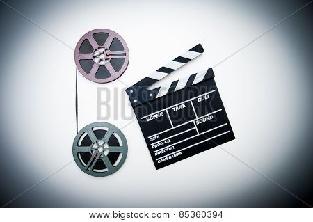 8Mm Purple And Grey Movie Reels And Clapper Vintage Color Effect