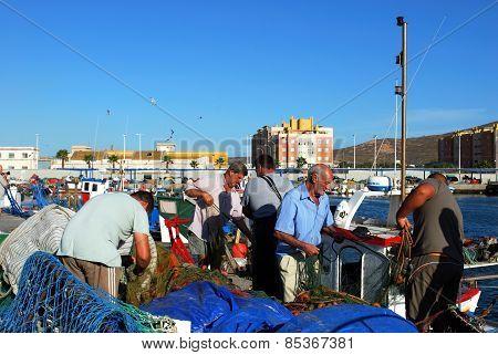 Fishermen in the harbour, Puerto de la Atunara.
