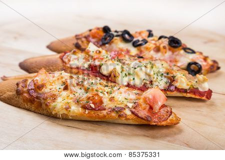 Assorti Bruscjetta With Sausage, Cheese, Tomato Fron Big White Baguette On Wood Background