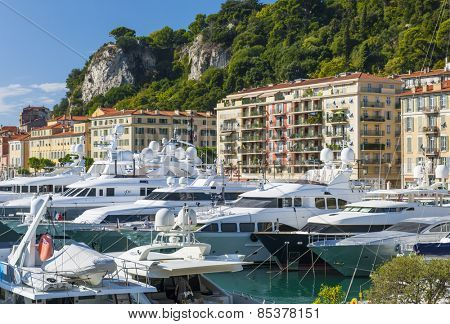 NICE, FRANCE - OCTOBER 2, 2014: Luxury yachts docked in Port of Nice, one of main harbors for the leisure boats sailing across the Mediterranean Sea.