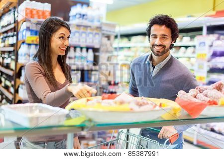 Couple shopping at the grocery store poster