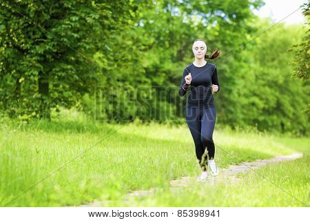 Happy Smiling Caucasian Sportwoman Having Her Regular Training Outdoors