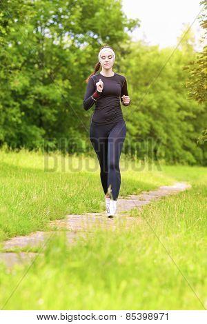 Caucasian Sportwoman Having Her Regular Training Outdoors
