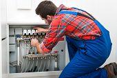 Technician servicing the underfloor heating poster