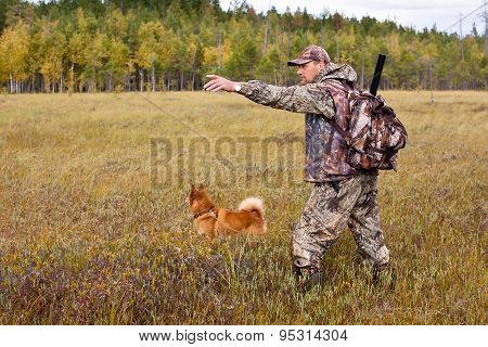 Hunter With Dog On The Swamp