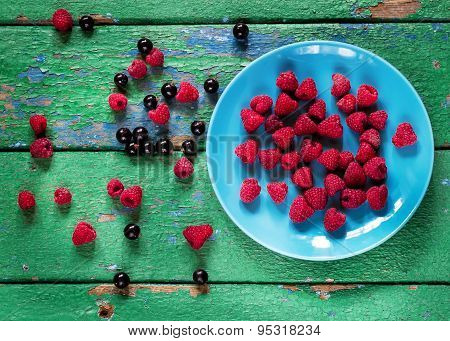 Summer Berries On Blue Plate On Old Rustic Painted Cracky Green (turqouise) Wooden Background.
