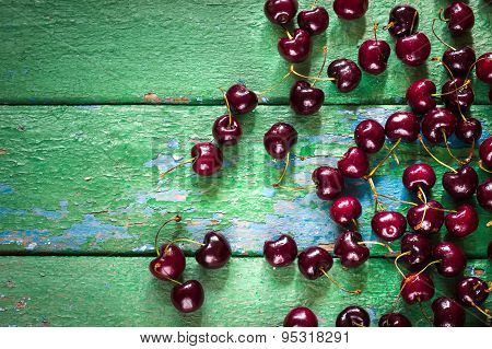 Cherry On Old Rustic  Wooden Background.