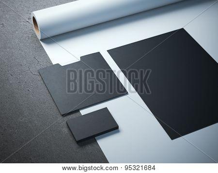 Black branding mockup on the white paper roll poster