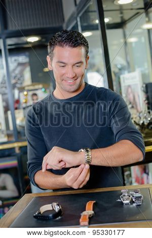 Man shopping for a watch