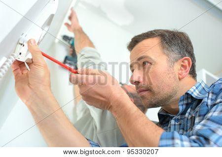 Builder installing an intercom