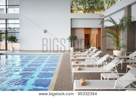 SOCHI, RUSSIA - JUL 27, 2014: Interior space with an indoor pool and loungers in the Hotel Radisson Blu Paradise Resort and Spa