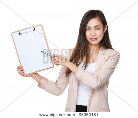 Young businesswoman pen point to clipboard with blank papera poster
