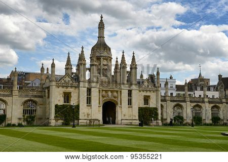 CAMBRIDGE, ENGLAND - MAY 13: Kings College Gatehouse and Gothic Clock Tower as seen from Inside Courtyard with Manicured Green Lawn, University of Cambridge, England on May 13, 2015
