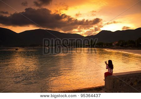 Young girl sit in sunset in Con Dao island, Vietnam