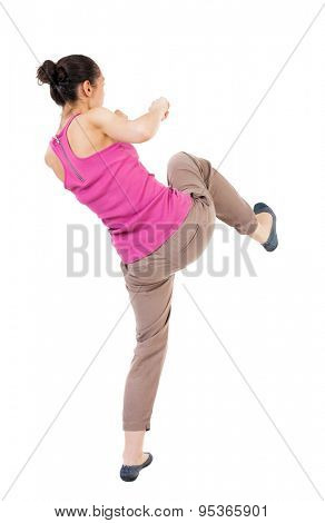 skinny woman funny fights waving his arms and legs. Rear view people collection.  backside view of person.  Isolated over white background. African-American is preparing his right foot.