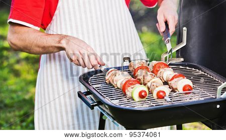 Chef prepares a barbecue on the grill