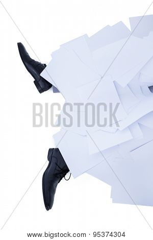 businessman burried under piece of paper on white background