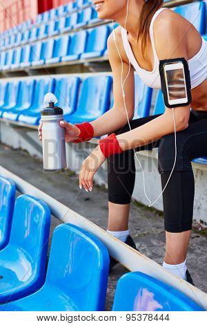 Modern girl in activewear spending time at stadium