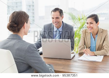 Business people conducting an interview in an office