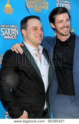BURBANK - JUNE 25: Geof Johns and Grant Gustin arrives at the 41st Annual Saturn Awards on Thursday, June 25, 2015 at the Castaway Restaurant in Burbank, CA.