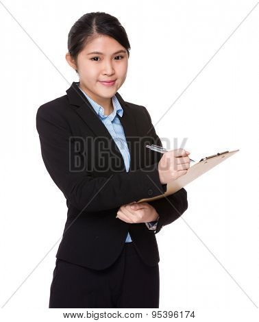 Businesswoman jot note the memo on clipboard