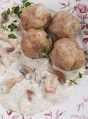 Bread dumplings in thick champignon mushroom sauce, rich and tasty vegetarian dish poster