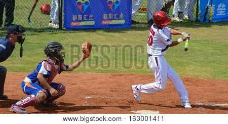 ZHONGSHAN GUANGDONGChina - October 27:unknown batter about to miss the ball in a baseball game on October 27 2016.