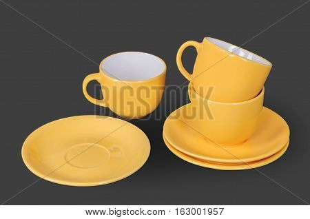 orange cup and saucer isolated on a gray background