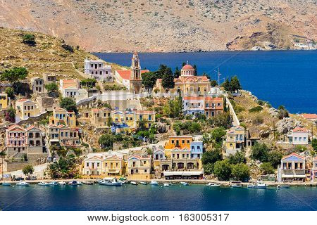 The picturesque coastline of Symi with beautiful old houses, Symi island, Dodecanese, Greece