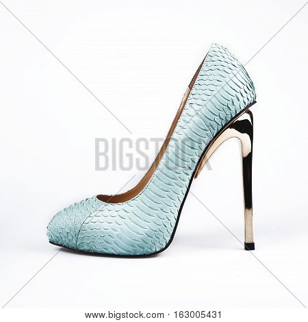 summer female blue shoes over white background