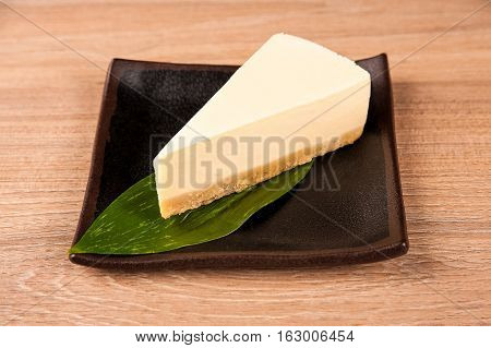 Cheesecake on a plate on a neutral neutral background