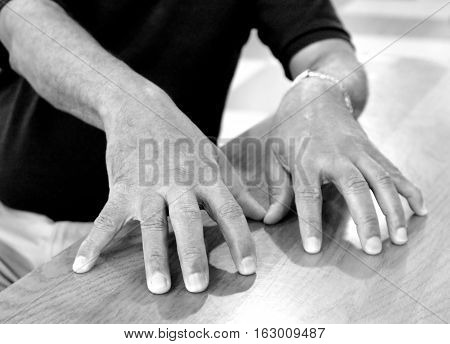 Jazz musician piano player hands resting on a table during intermission.