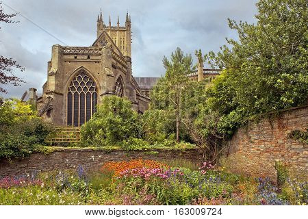 Wells Cathedral (Cathedral Church of Saint Andrew), Wells Abbey and park on sunny day, Somerset, England