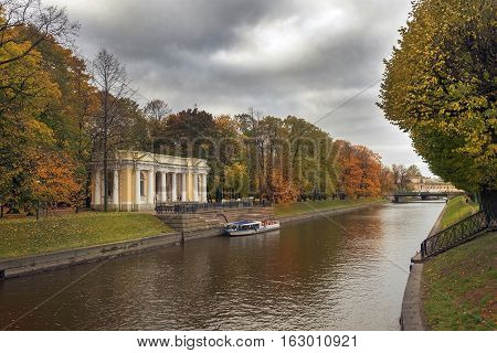 small pavilion built in empire style by Carlo Rossi in Mikhailovsky Garden (Summer Garden) and Moyka river, Saint Petersburg, Russia