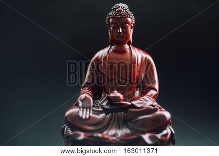 Buddha statue with incense. Deity and symbols of Buddhism. The practice of Buddhism and its symbols. Spiritual life of Asia