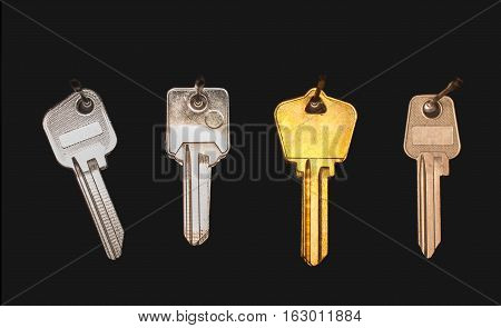 Blank keys on a black wall in a workshop. One of them golden