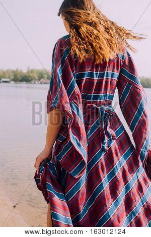 Beautiful Hippie Girl Walking Near The Shore Girl In A Dress, Conscious Lifestyle. Film Texture & Un