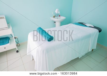 fragment of view of amazing beautiful inviting comfortable spa room massage bed