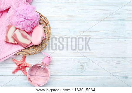 Pink Towels With Soap And Wisp On White Wooden Table