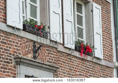 Christmas decoration of an exterior wall of a house with brickwork.
