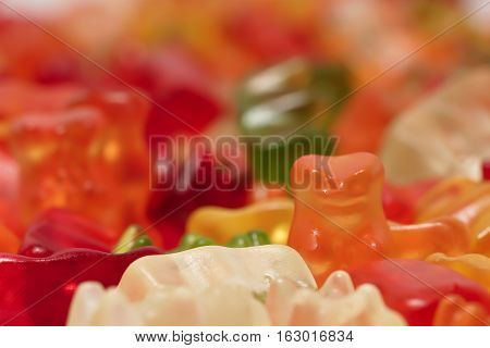 Colorful sweet gummibars lying on a table