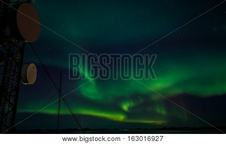 Telecomminication tower and Northern lights nearby Nuuk Greenland